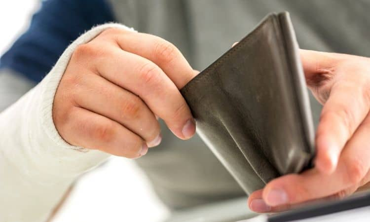 Man's hands opening a wallet.