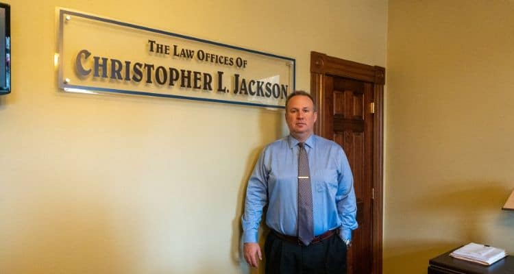 Slip and Fall Injury Lawyer in Greater Cincinnati Christopher Jackson in his office's entrance.